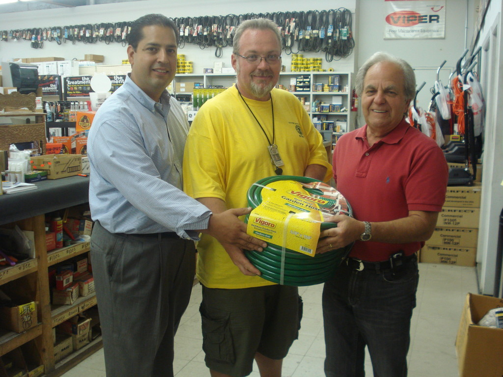 Smith Park recieves support from Victor Supply in the West town community. On behalf of Smith Park, SPAC President David R. Ramos receives garden hoses from Victor Supply. Mr. Mike Victor, owner of Victor Supply stated he has been in the community for over 20 years and his donation is one way of supporting Smith Park. Pictured L - R: President David R. Ramos, Mr. Mike Victor and Frank Bogatitus, Physical Instructor at Smith Park.