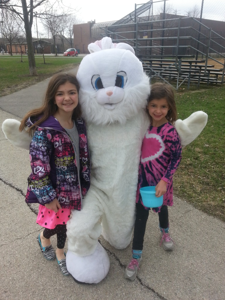 Children from the community celebrate Easter at Smith Park. Past President Erich Muellner proudly plays the Easter Bunny.
