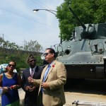 Smith Park Advisory Council President David R. Ramos and Smith Park Neighborhood Alliance President Kathy Smith discuss plans to refurbish the army tank at Smith Park with American Legion Post Commander Byron Watson.