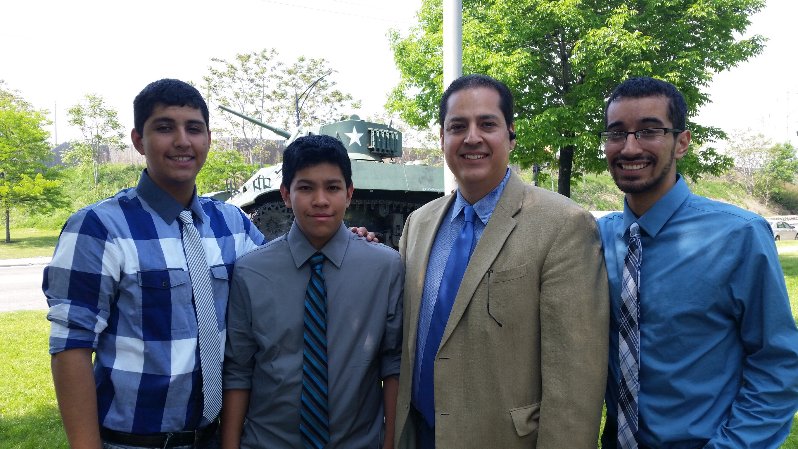 Smith Park Advisory Council President David R. Ramos with his three sons at the 2014 Memorial Day celebrations at Smith Park