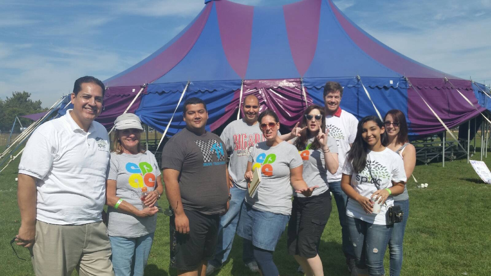 Members of Smith Park and Commercial Park celebrate opening day of the circus at Smith Park.