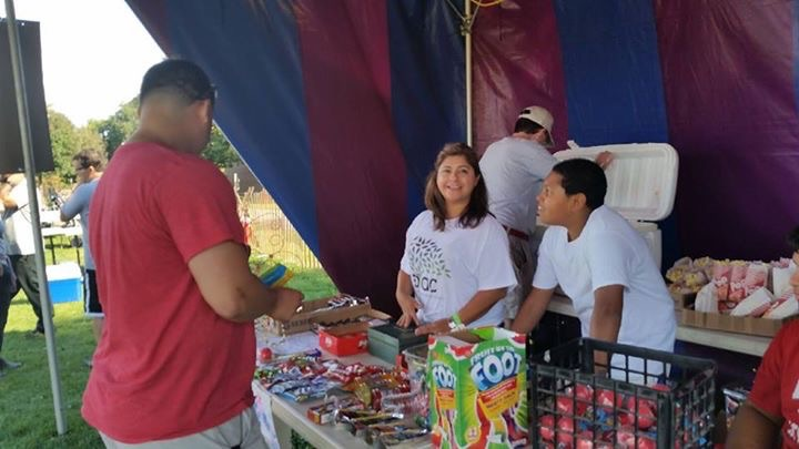 Vice president Nani Almendarez helps out at the concession stand with volunteers from different high schoolers who earned community service hours.