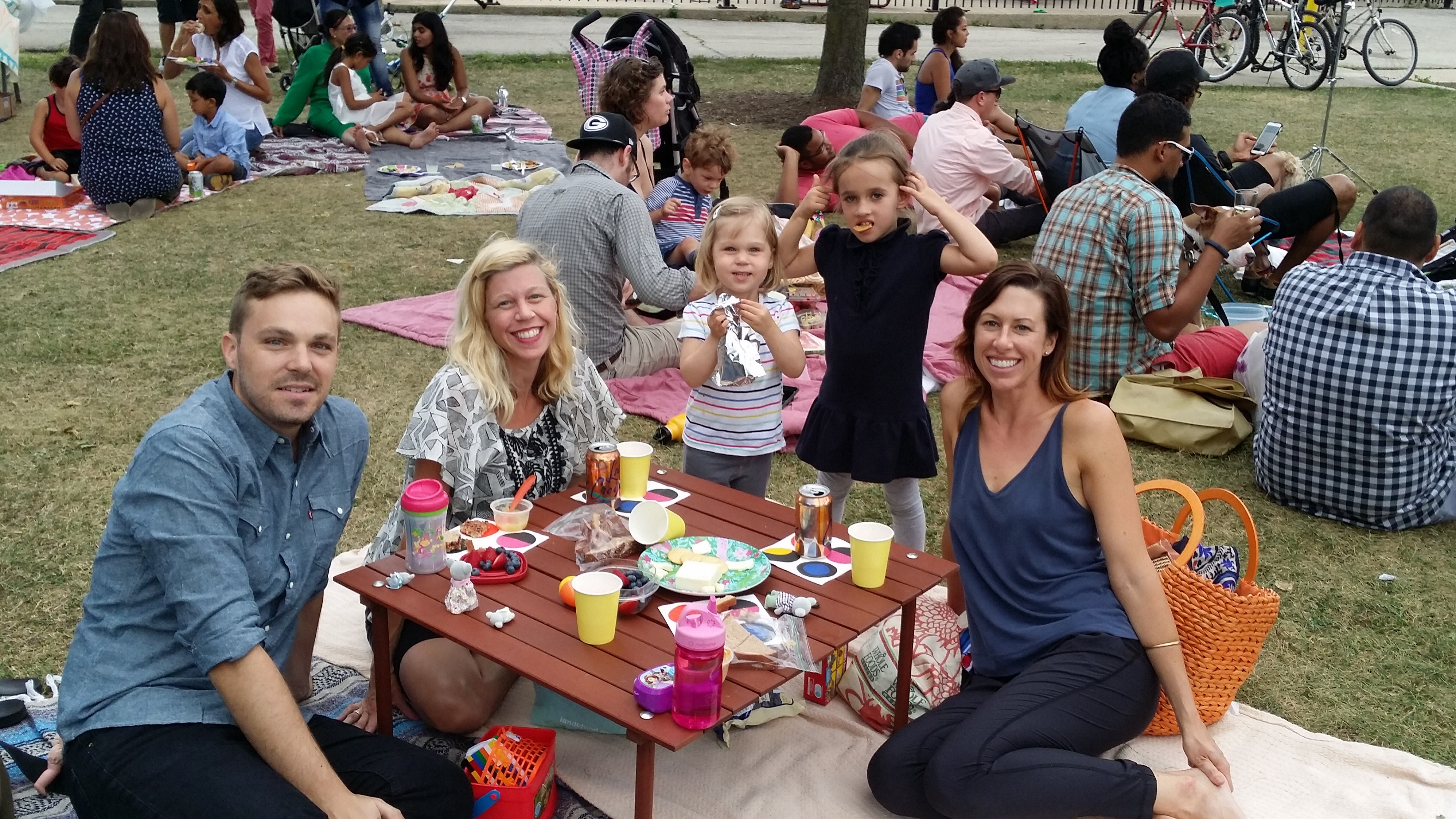 Smith Park host Contrabanda Latin Band. pictured L-R: Community members Patrick, Kerry, Lucy, Flo, and Stacey enjoy the summer breeze and great music at Smith Park.