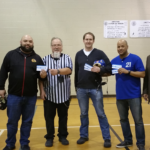 David R. Ramos, president of the Smith Park Advisory Council presents the 2017 Auto Show tickets to the volunteer coaches for the children's floor hockey donated by Chicago Northside Toyota.