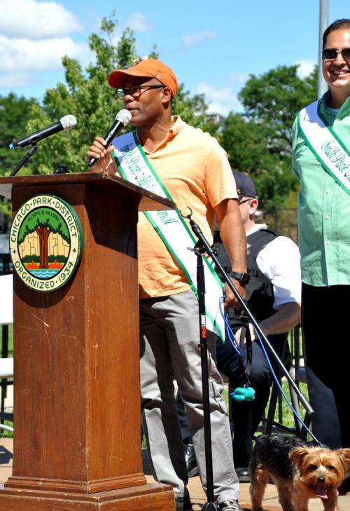 Alderman Walter Burnett, Jr. speaks at the Smith Park Dog Parade